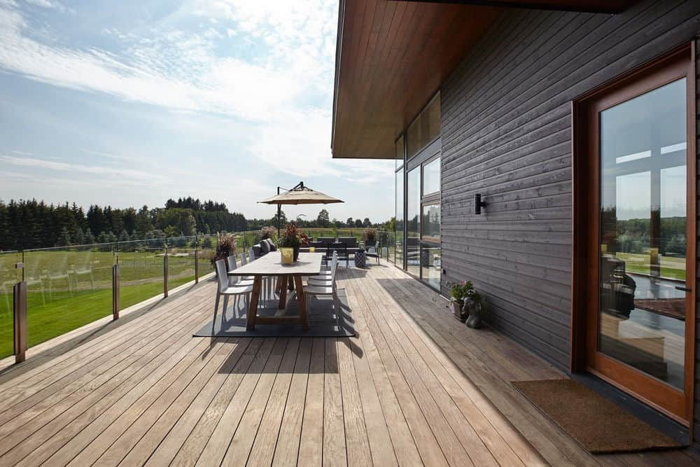 The Home Also Boasts A Deck Area Featuring A Patio, Outdoor Dining And  Sitting Lounges