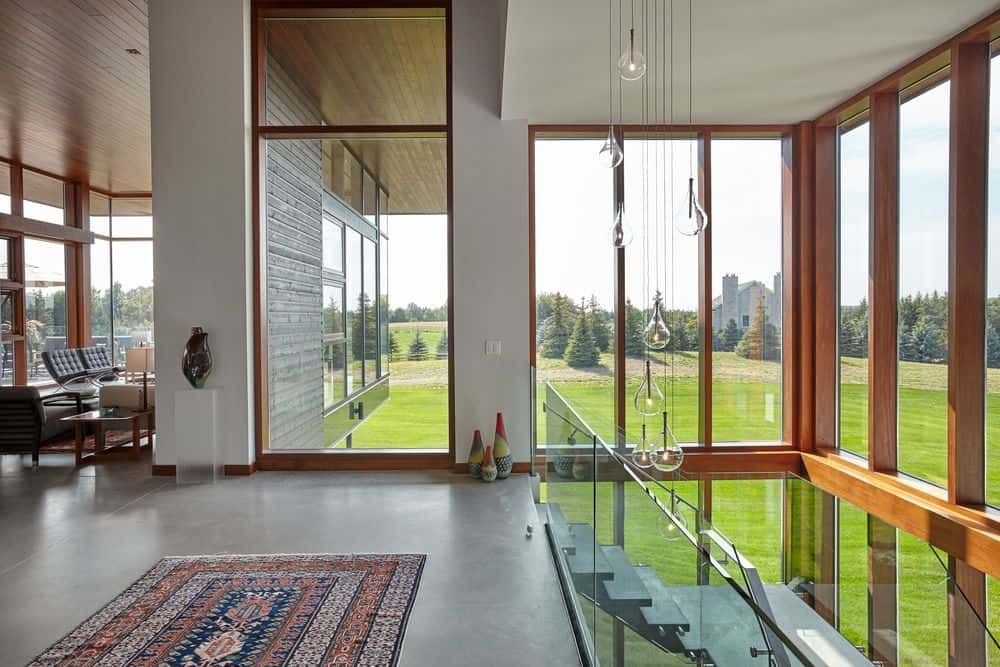 The home features glass walls all over the place. Photo credit: Maciek Linowski