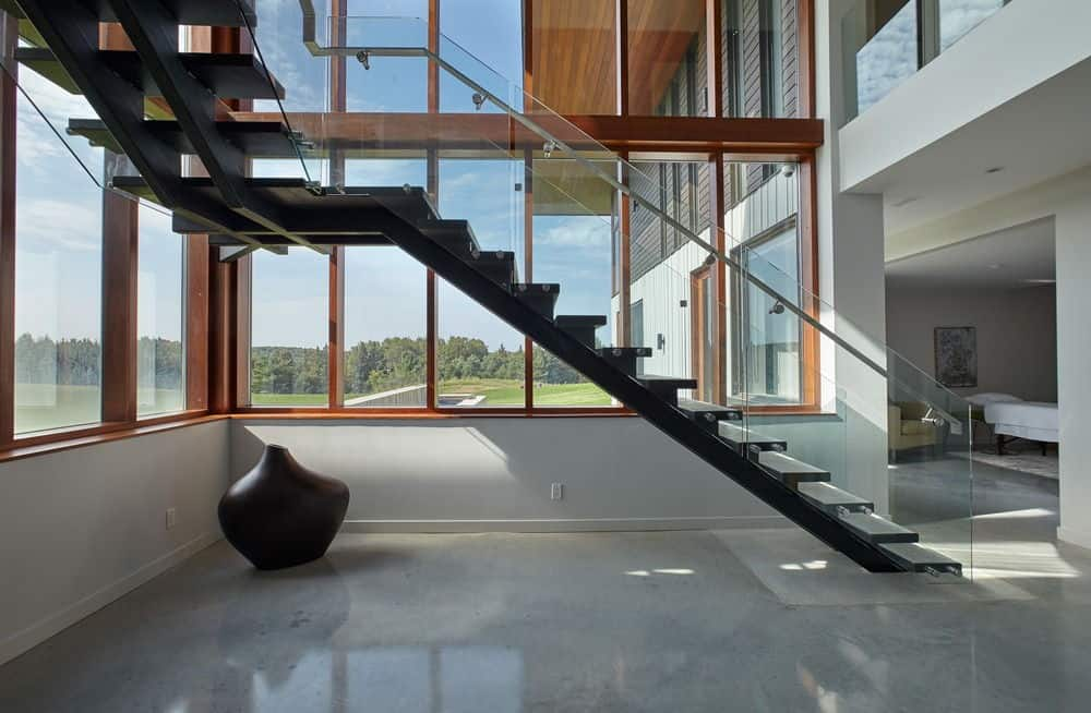 Another look at the home's modish staircase. Photo credit: Maciek Linowski