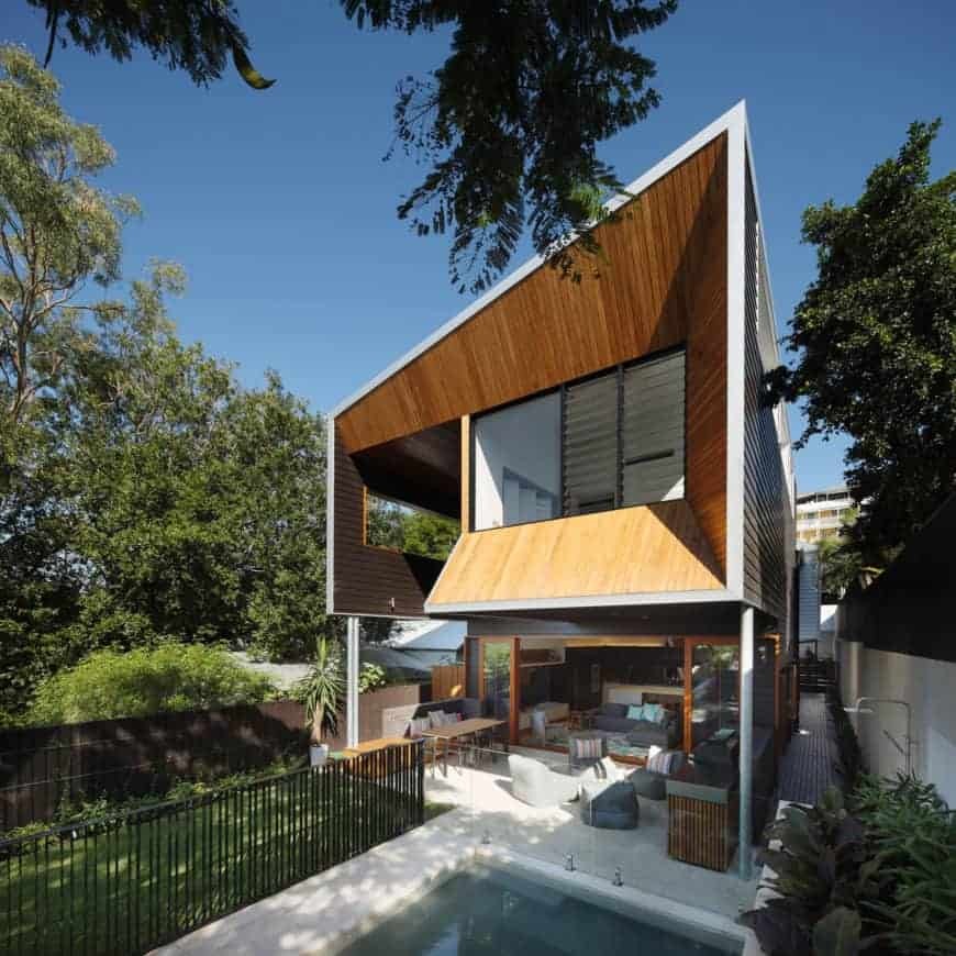 This house has a strikingly beautiful exterior design and has a small garden area.