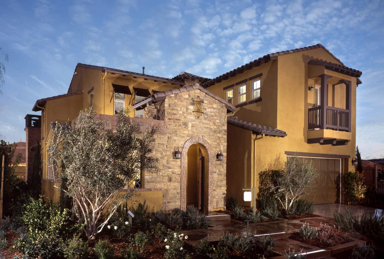 Luxury house with yellow stucco exterior and stone decoration for the foyer.