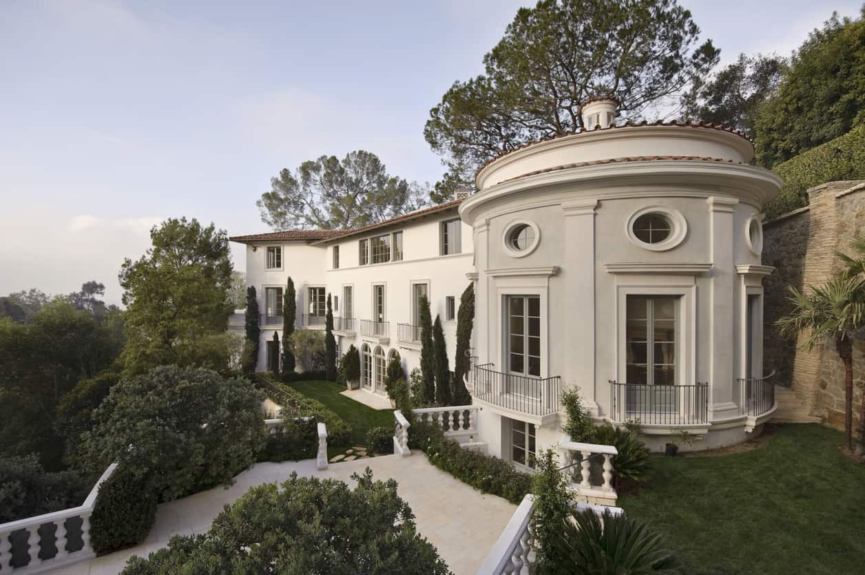 Early morning sunlight shines on a large estate home in Bel Air California.