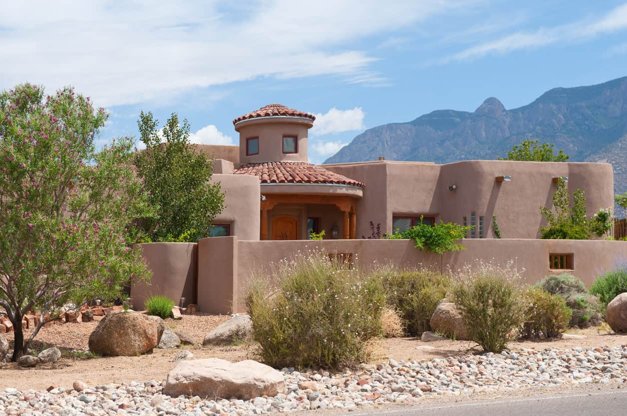 Another adobe house in a desert landscape.