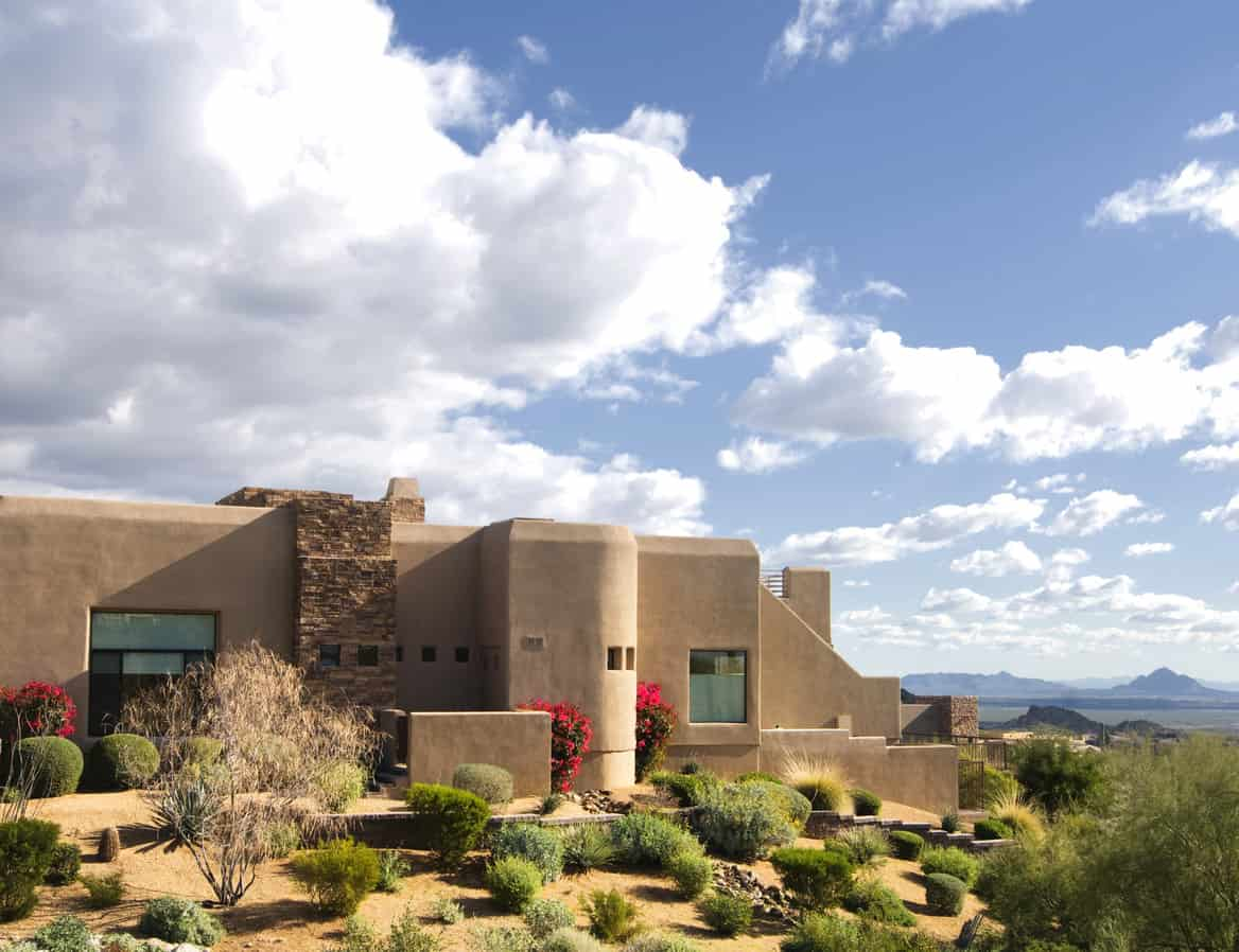 Large home located on mountain butte overlooking desert landscape near Scottsdale, AZ.