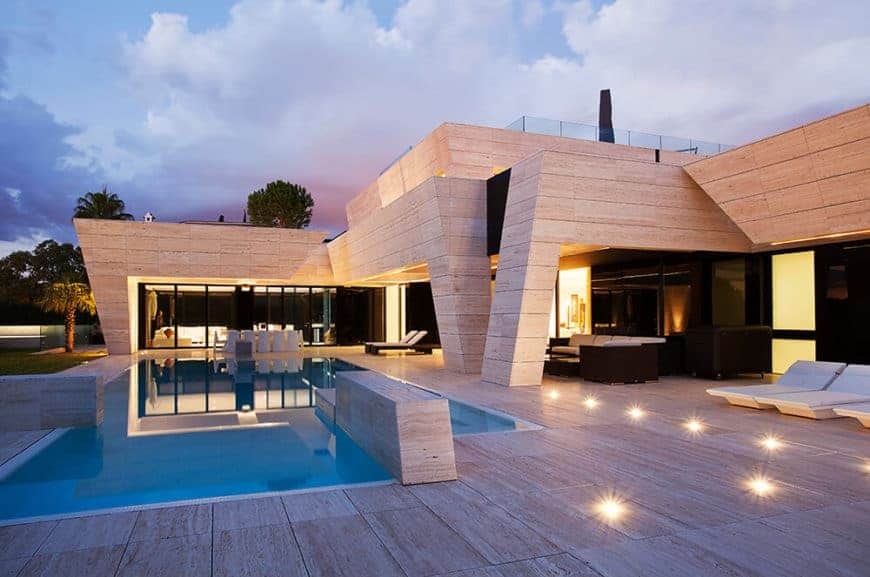 This house has a thick wooden exterior along with a rooftop and a swimming pool area.
