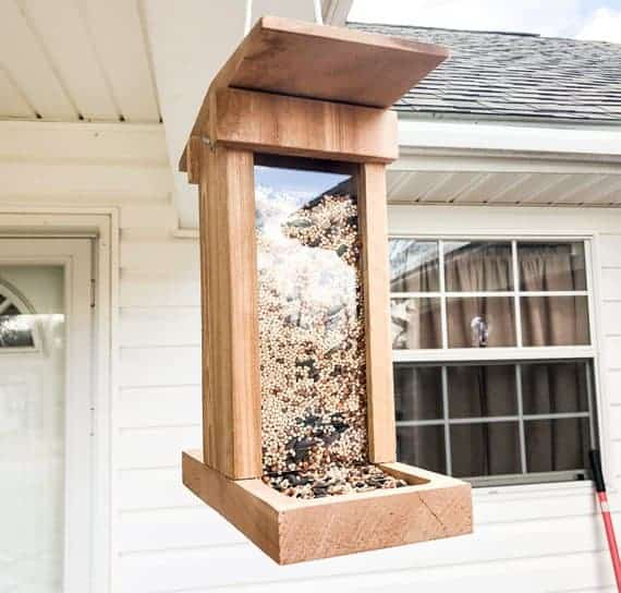 Tall and sturdy, wooden bird feeder, hand-made to perfection.