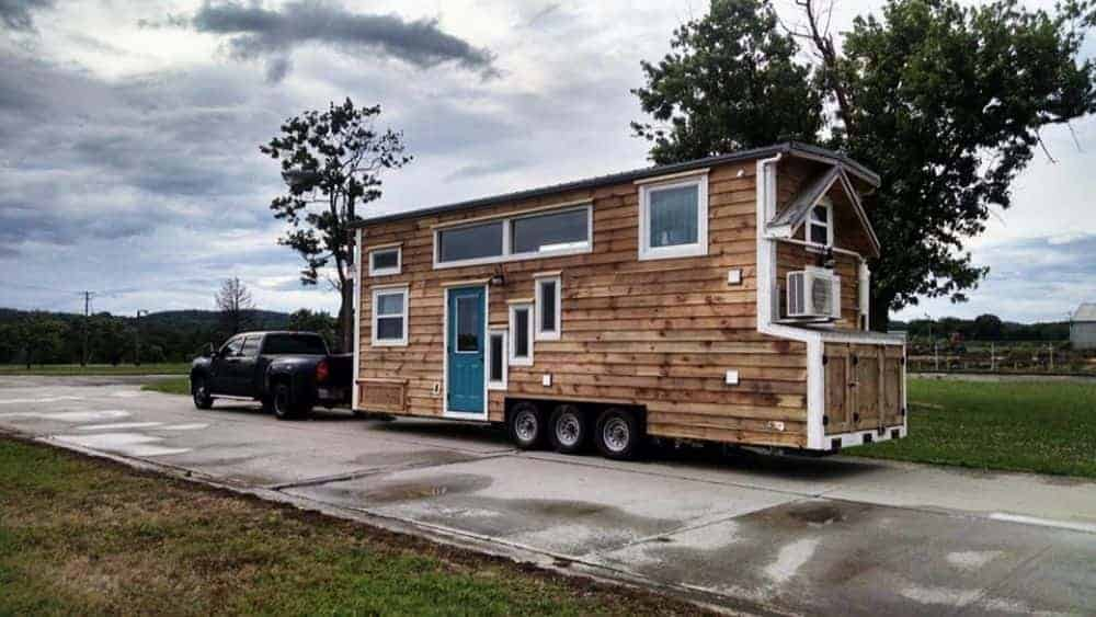 A tiny wooden house that is movable.