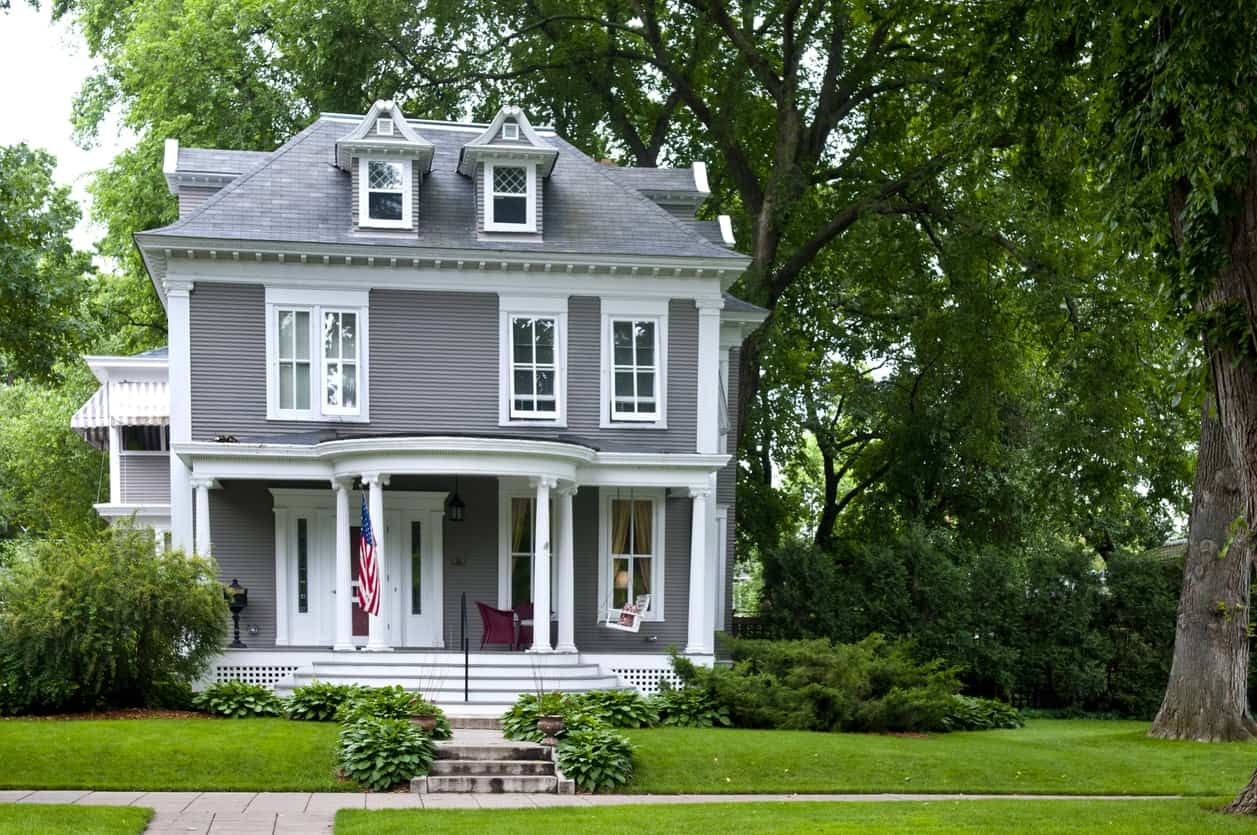 This Traditional Midwest house's gray and white color scheme pulls off a classic look that won't go out of style.