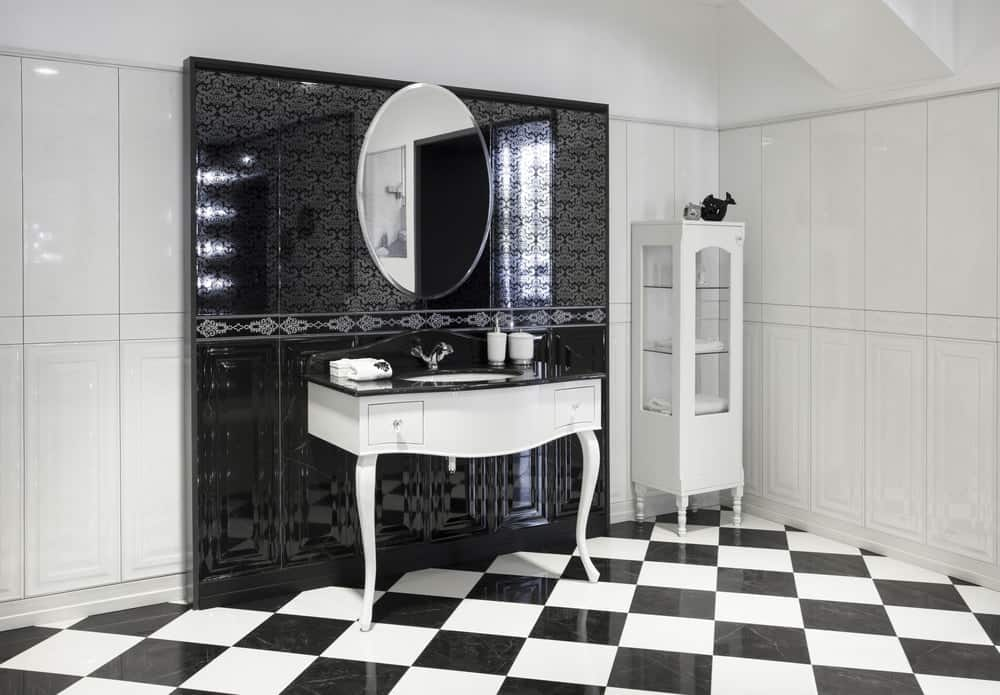 An undermount sink vanity that goes well with the rooms's black and white theme.