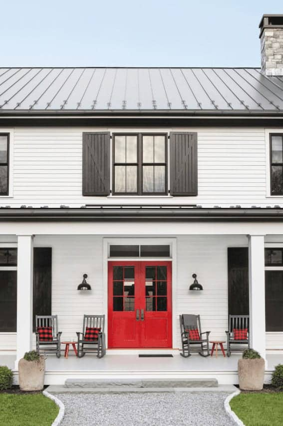 An upstate farmhouse with a bright wooden exterior with a shade of red.