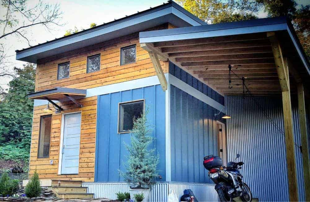 This house features a wooden exterior along with a small garage.