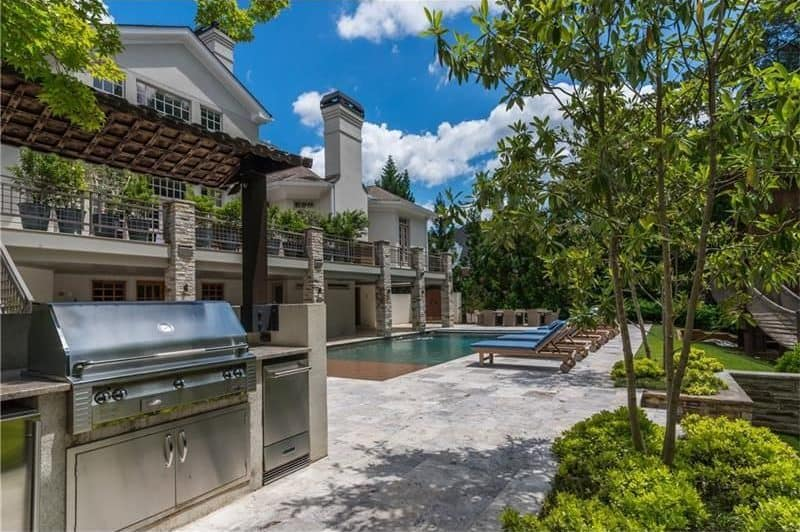 The outdoor kitchen offers top-of-the-line appliances and has its own dining area.