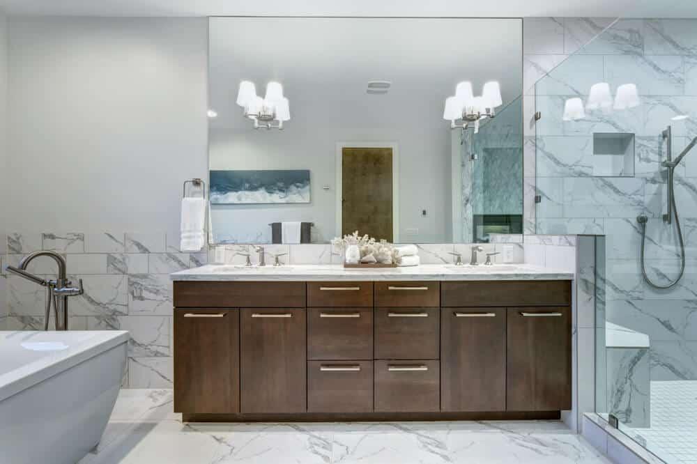 Wooden vanity cabinet inside a bathroom.