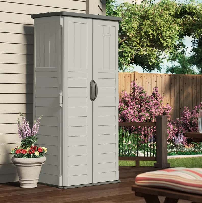 Vertical tool shed with light gray color.