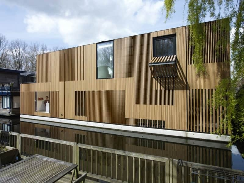 A water villa floating home with a stylish wooden exterior design.