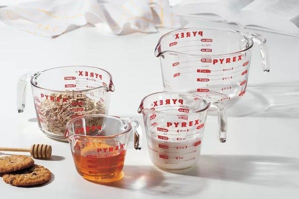 Wet measuring cups with different sizes.