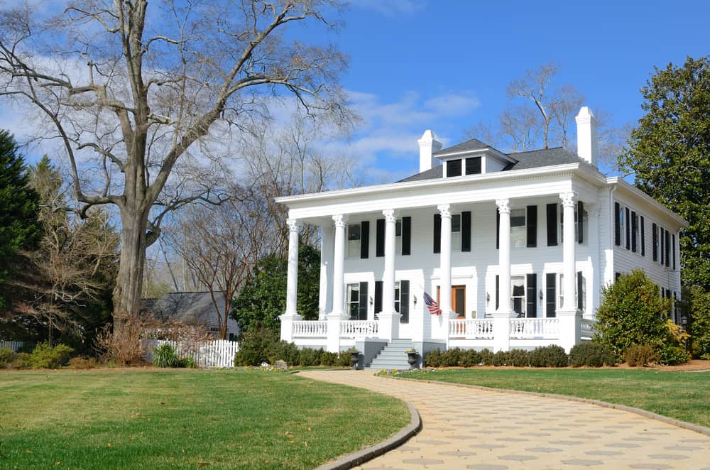 Historical antebellum Greek Revival house with circular driveway