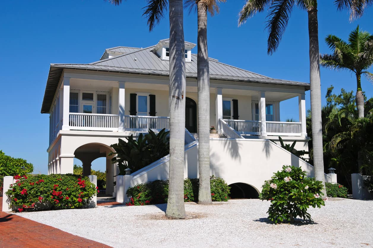 White beach house elevated with veranda