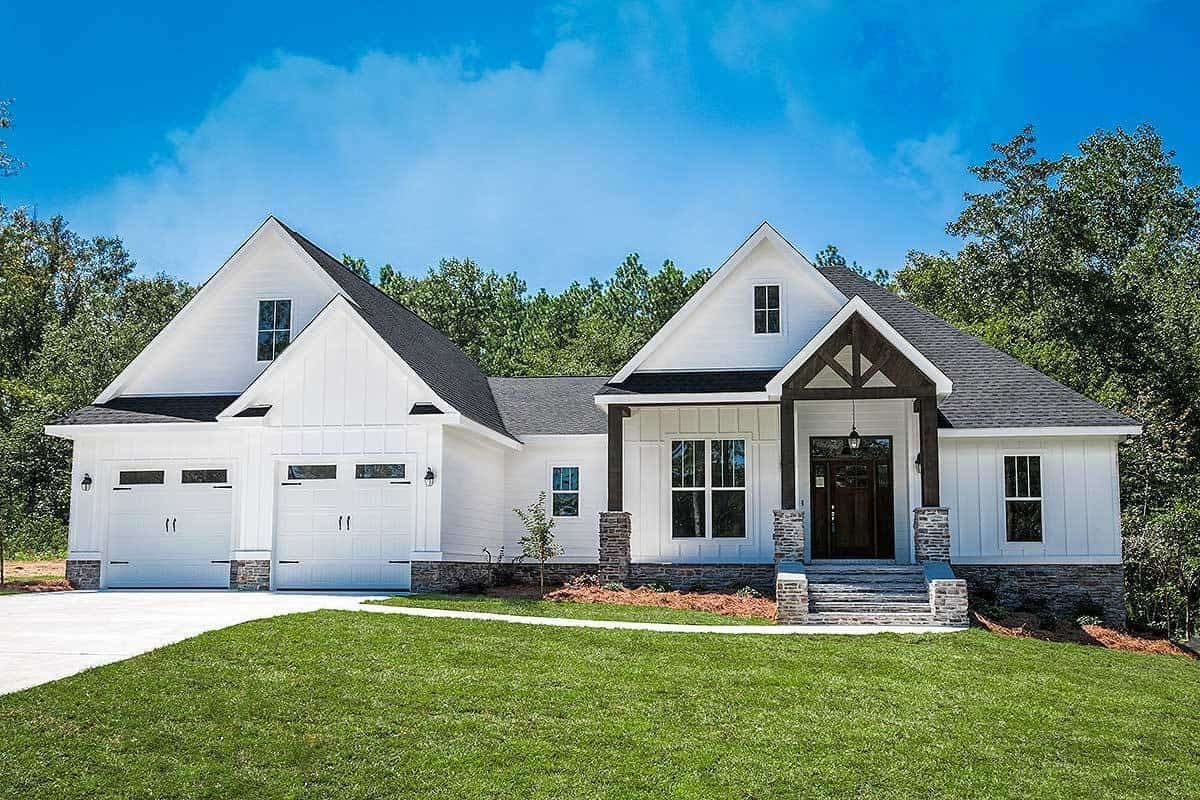 White contemporary craftsman house with carriage garage doors