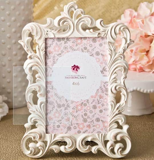 A white, fancy picture frame surprisingly made of plastic only.