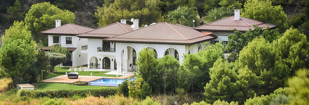 White Spanish mansion with huge grounds