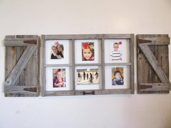 Portraits of family members displayed on DIY picture frame made of old barn-style window frames.