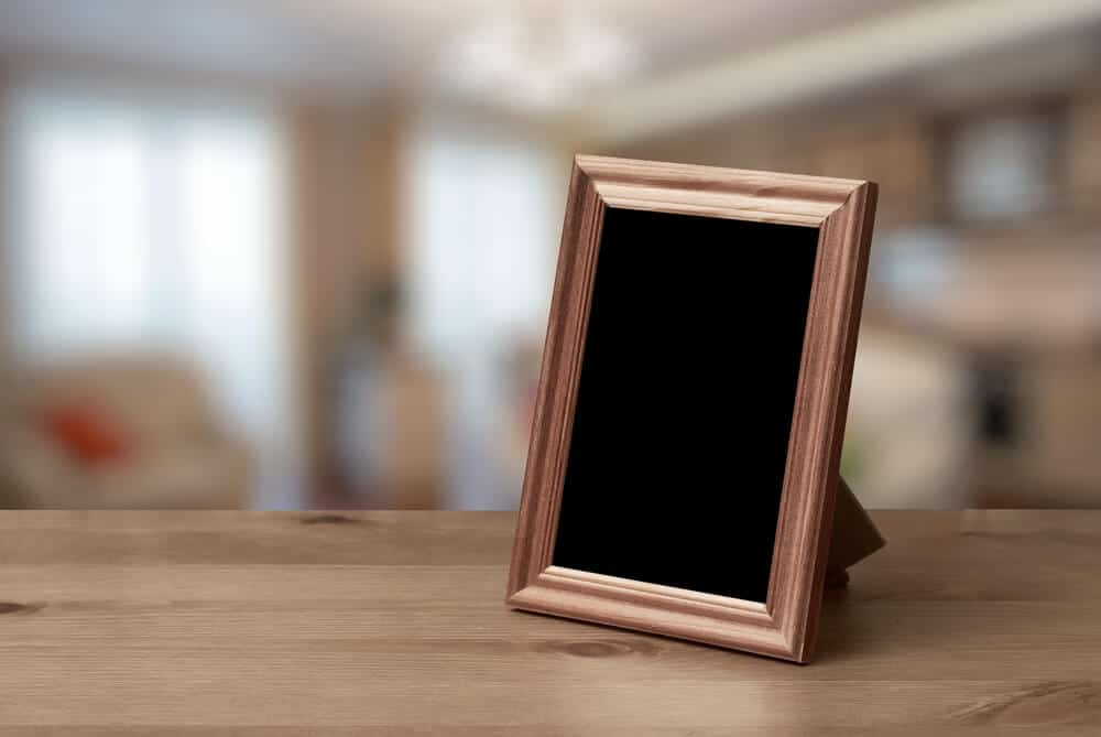 A small wooden frame above a wooden table.