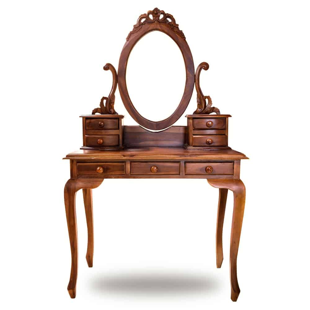 Wooden vanity with an oval-shaped mirror.