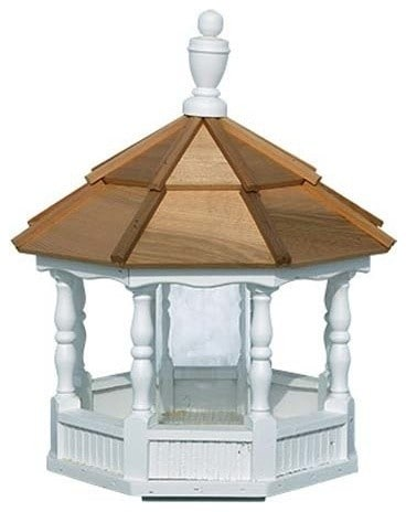 A wooden, traditional Gazebo as a bird feeder.