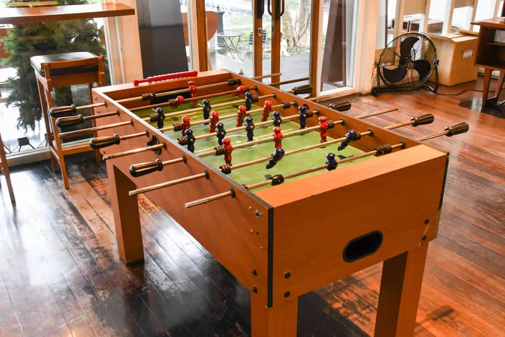 Foosball table made of fine and durable wood.