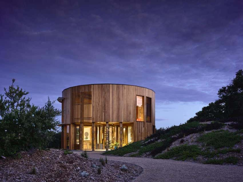 Round wooden beach house with a magnificent exterior design.