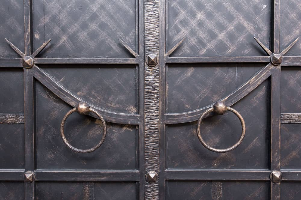 Wrought iron door with circular handles.