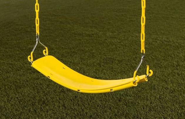 A bright yellow swing for single usage only.