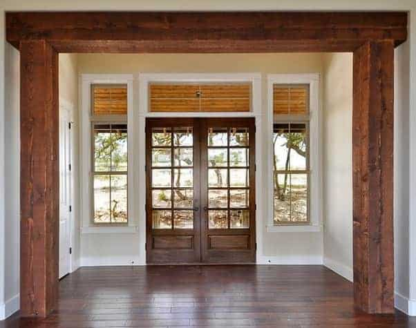 Rustic French style double wood door offering entry into the home