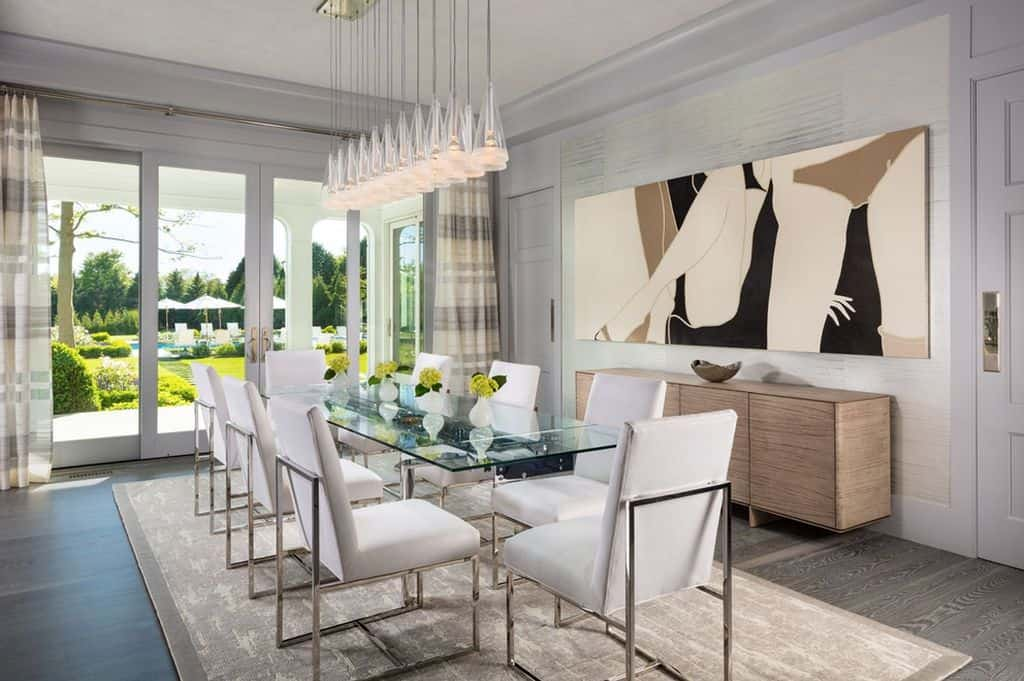 Formal dining room with yet another fabulous pendant-like chandelier looking out over the sprawling grounds.