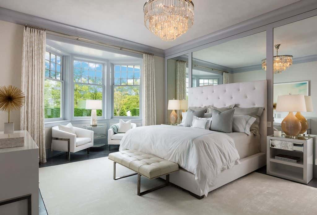 Now that's really nice for a guest bedroom.  Sitting area in bay window and chandelier.