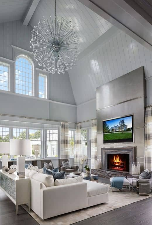 Get a look at that bursting chandelier suspended from soaring cathedral ceiling in the family room.