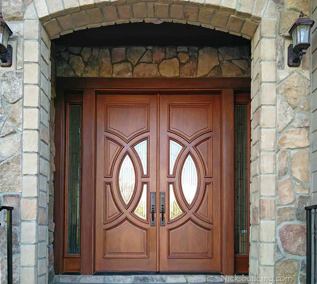Wood entry door with engraved Olympus rings