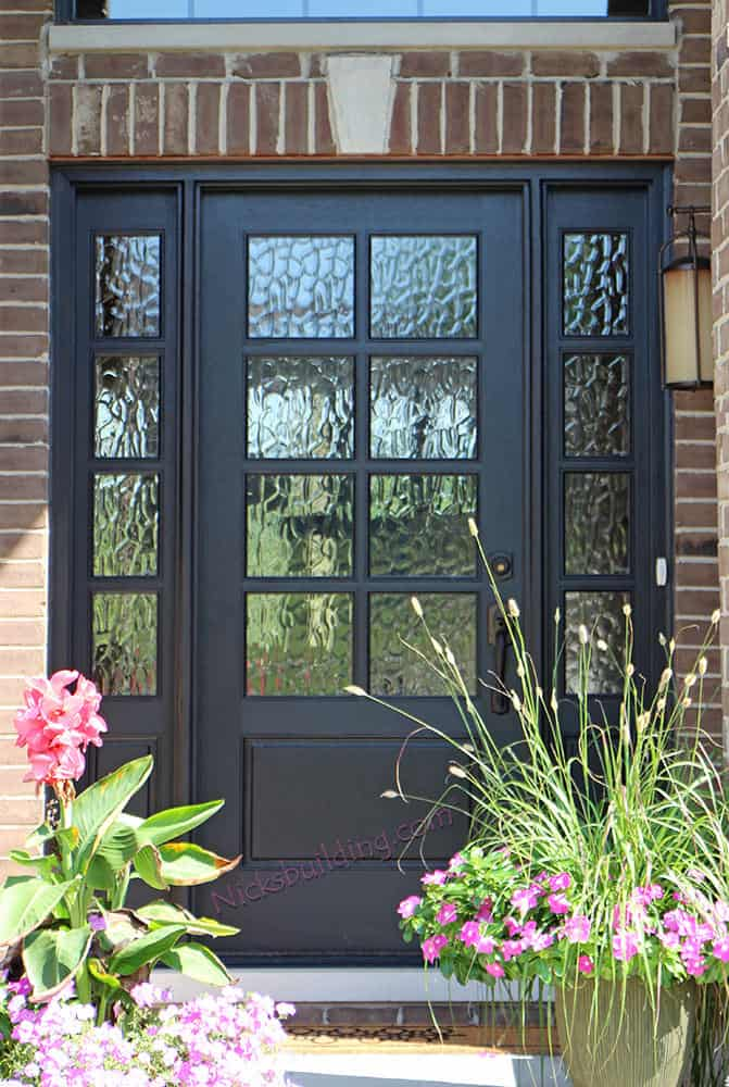Dark gray front door with a series of glass panels