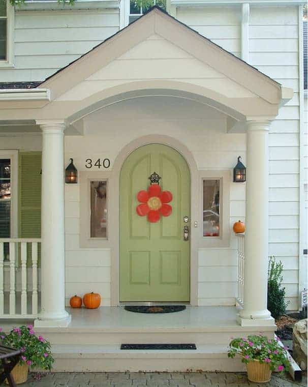 Arched green single front entry door made with solid wood