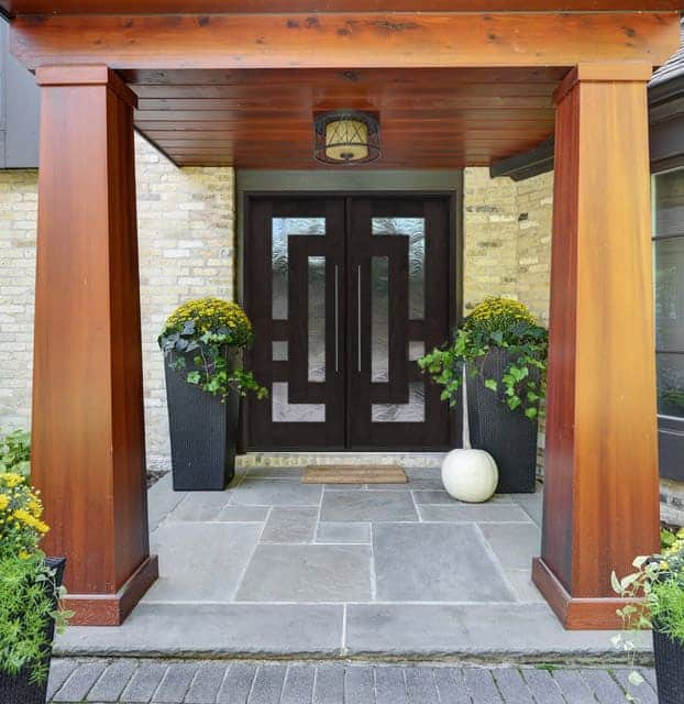 Contemporary double dark wood and glass front entry door with geometric pattern