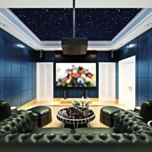 Cool home theater with blue walls and huge u-shaped tufted sectional sofa.