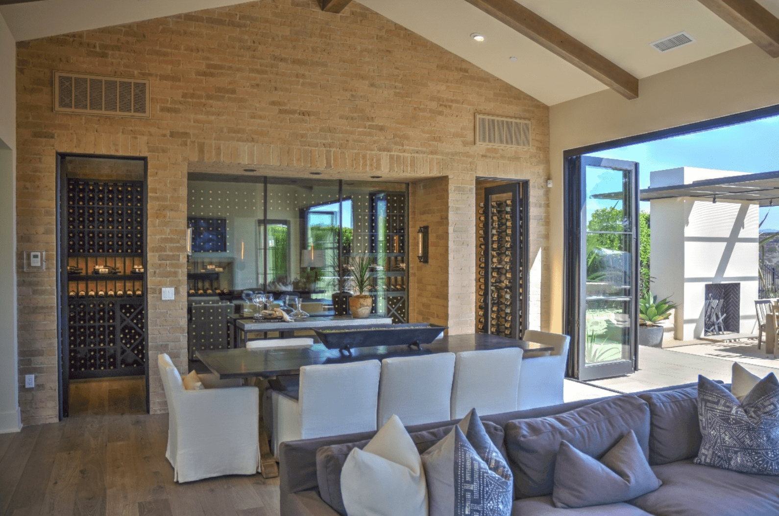 Double entry, glass-faced wine cellar directly off the indoor-outdoor dining room and living room.