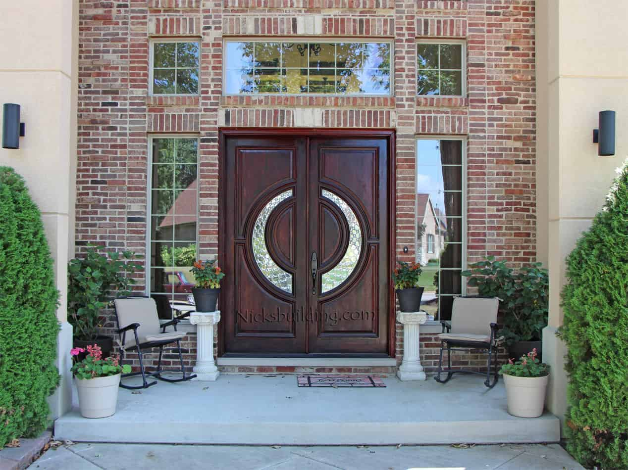 Tiffany style double wood front door with a diamond-like ring design