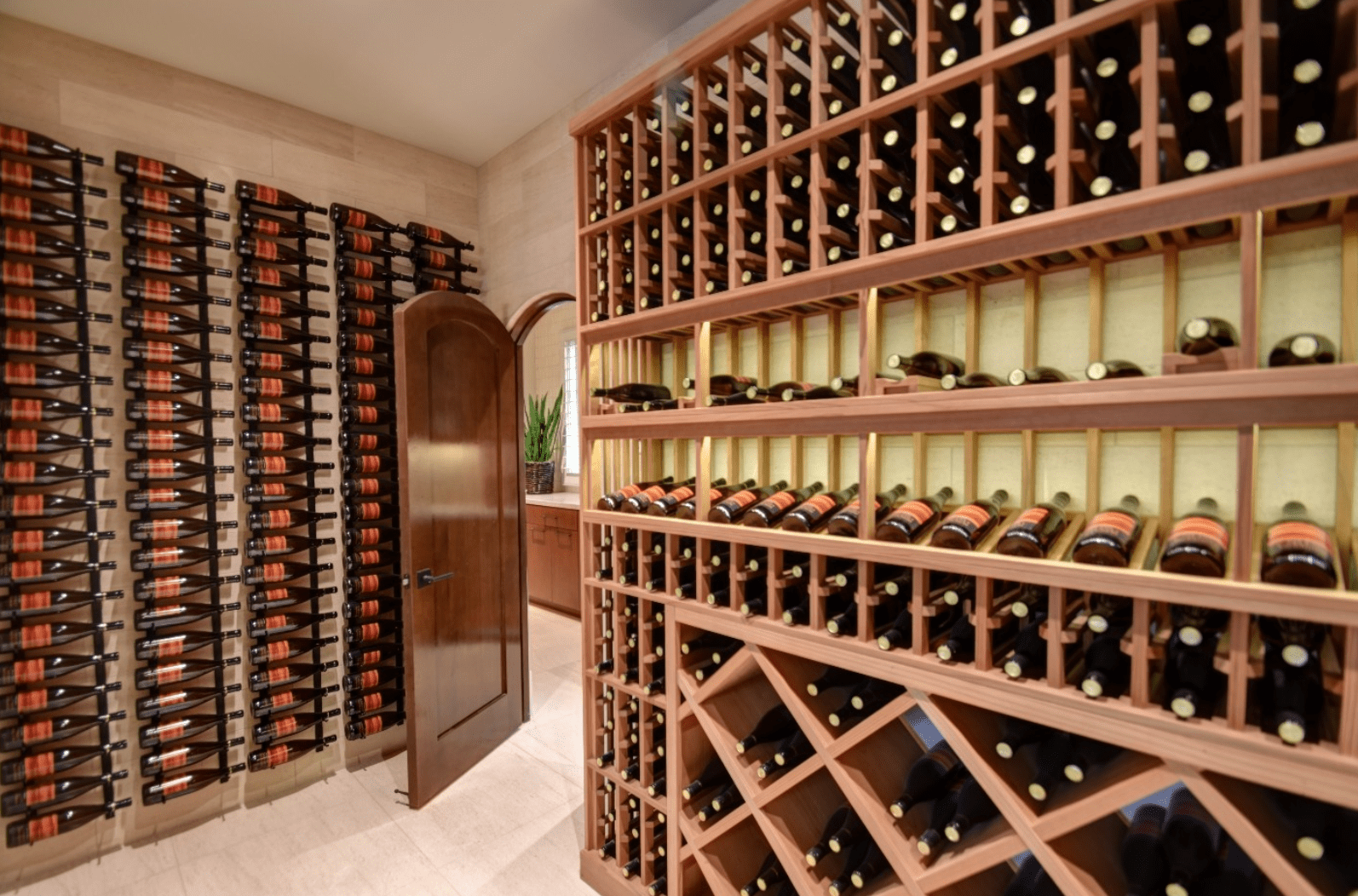 Vertical wine racks mounted on a light wooden plank wall along with a custom designed rack accented by cross cut wine racks.