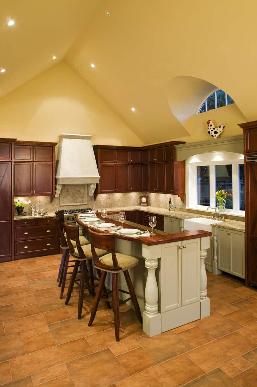 Assuming you don't have an upper floor above your kitchen you can create some form of vaulted kitchen ceiling like this. It definitely creates the perception of a larger space.