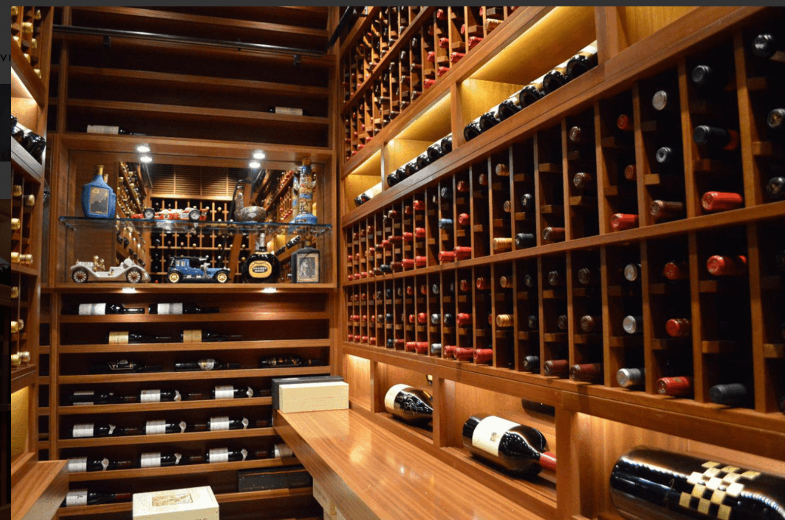 Gorgeous custom designed and built wine cellar with tasting bar and open glass shelving in addition to the myriads of wine bottle storage space.