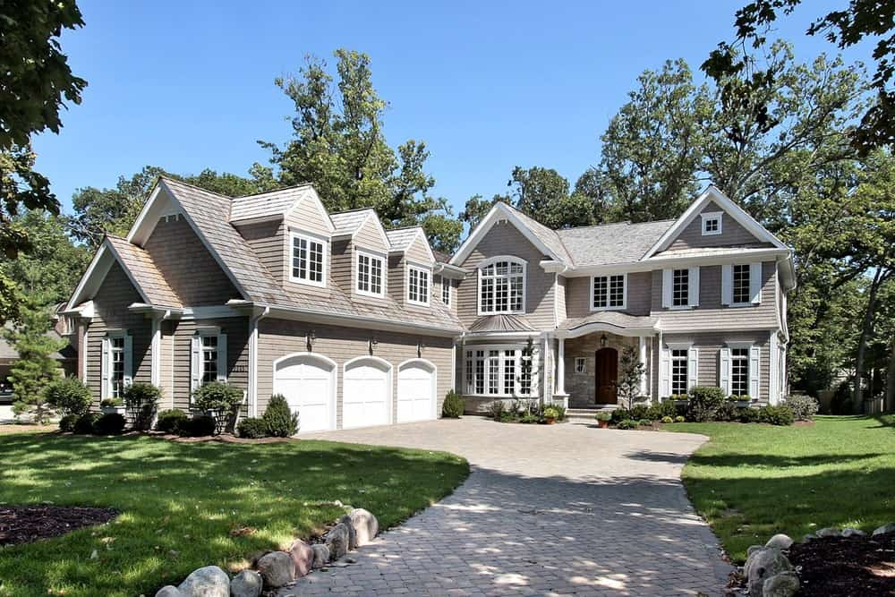 New house with a very nice long driveway.