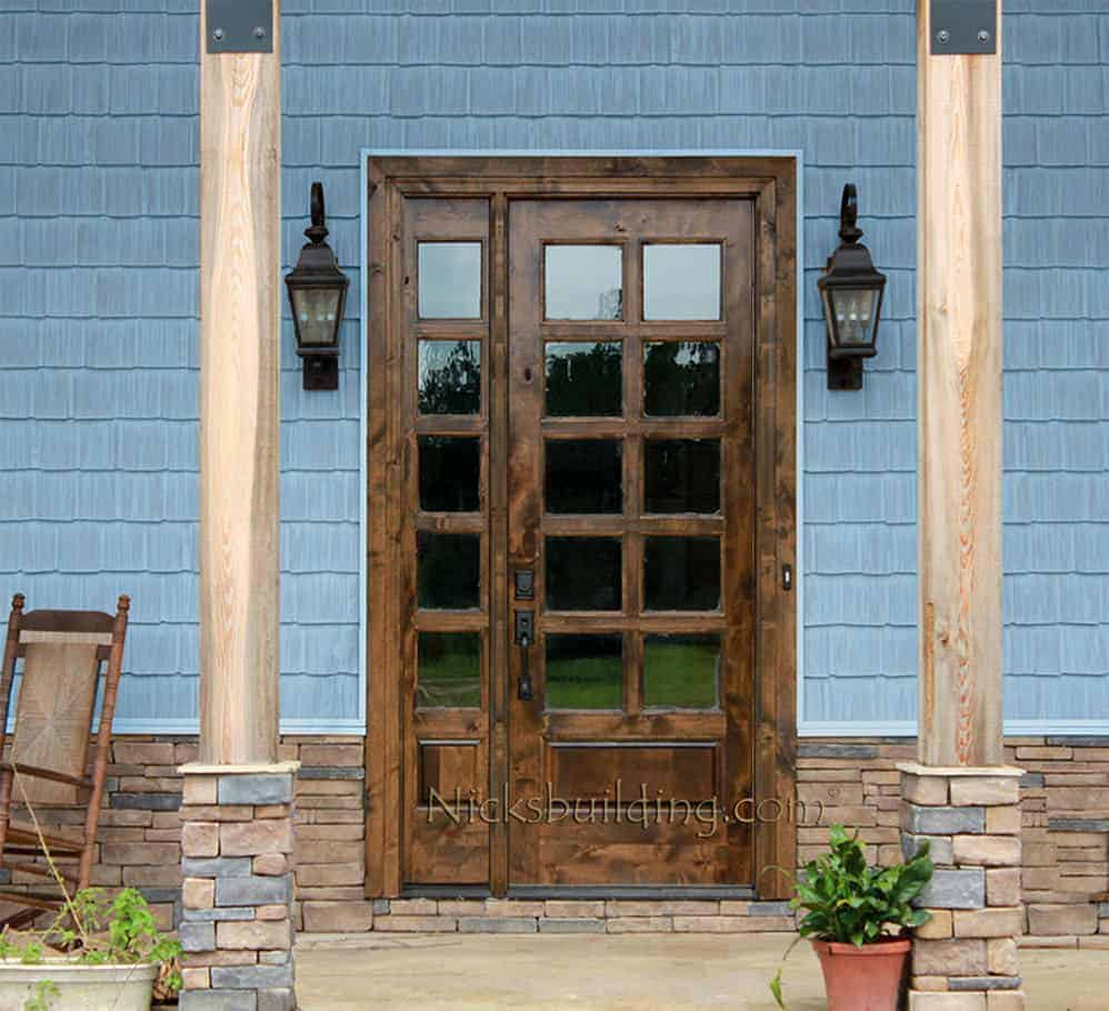 Rustic Tuscan style wood front entry door with a series of glass windows.