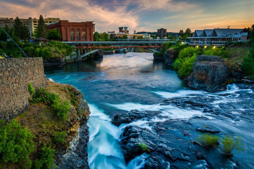 Photo of the Spokane River flowing past downtown Spokane, WA